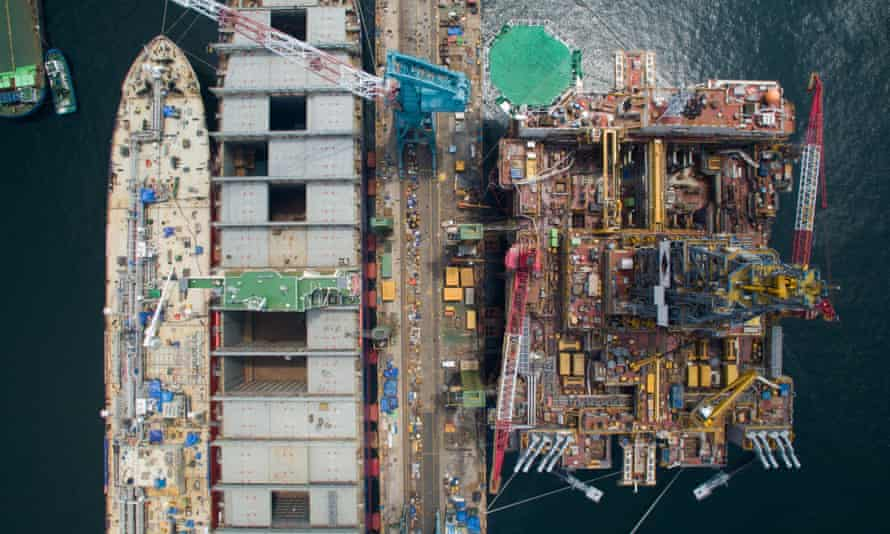 Liquefied petroleum gas (LPG) tankers, left, and a drill rig in Ulsan, South Korea.