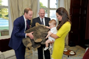 Prince George is presented with a stuffed toy wombat given to him by the Australian governor general, Sir Peter Cosgrove