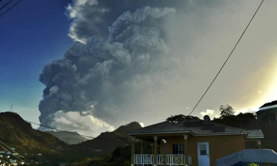 Ash rises into the air as La Soufrière volcano erupts on the eastern Caribbean island of St Vincent, 13 April 2021.