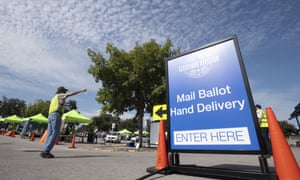 Travis county election officials collect mail-in ballots in the only authorized facility in the county on 7 October.