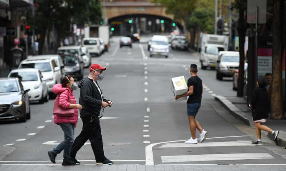 Pedestrians seen wearing a face mask Sydney
