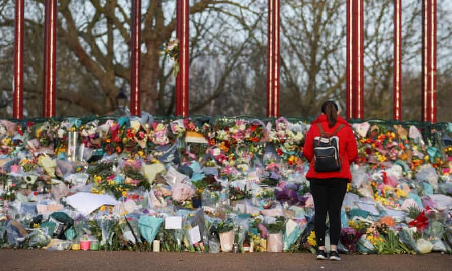 A memorial site at the Clapham Common Bandstand in London in March 2021, following the kidnapping and murder of Sarah Everard.