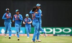 Radha Yadav (right) of India celebrates a wicket with captain Harmanpreet Kaur.