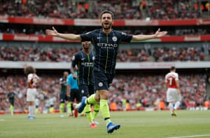 Bernado Silva celebrates scoring the second goal for Manchester City to beat Arsenal 2-0 at the Emirates Stadium.