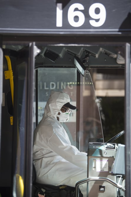 The driver of a New Orleans RTA bus wears protective clothing to protect against coronavirus on 26 March 2020.