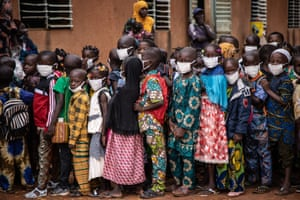 Pupils wearing face masks wait for the opening of their primary school on the first day of the new school year in Ouagadougou.