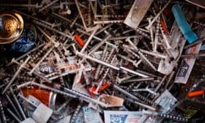 Discarded needles are seen at a heroin encampment in the Kensington neighborhood of Philadelphia.