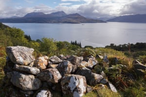 Lichen-covered ruined walls in Leitir Fura, with the Sound of Sleat in the background.