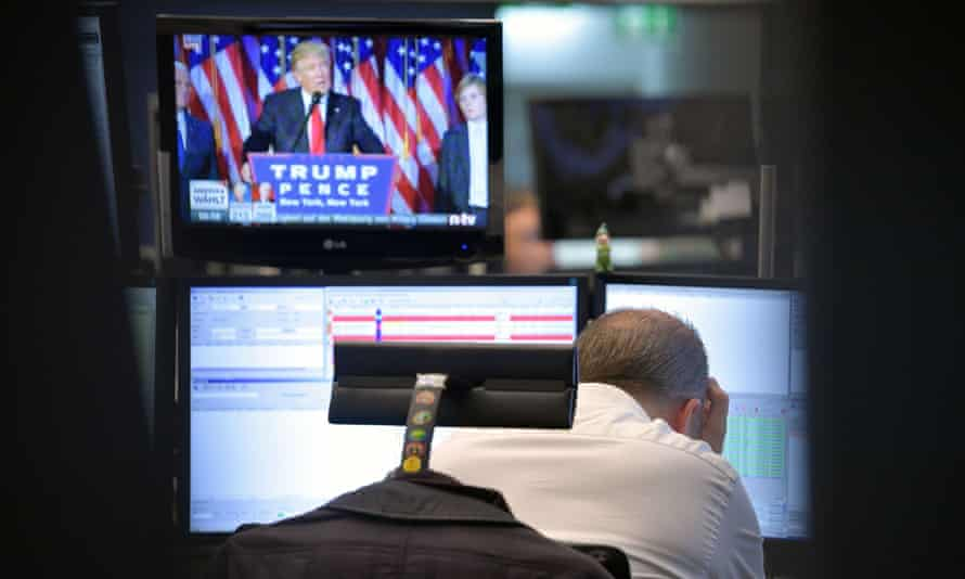 A trader reacts as he watches Donald Trump's speech at the Frankfurt Stock Exchange.