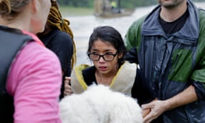 Lanie Gould, age 11, reacts after being helped back on to dry land after being rescued from their home along Cypress Creek at Kuykendal 15 miles northwest of downtown Houston.