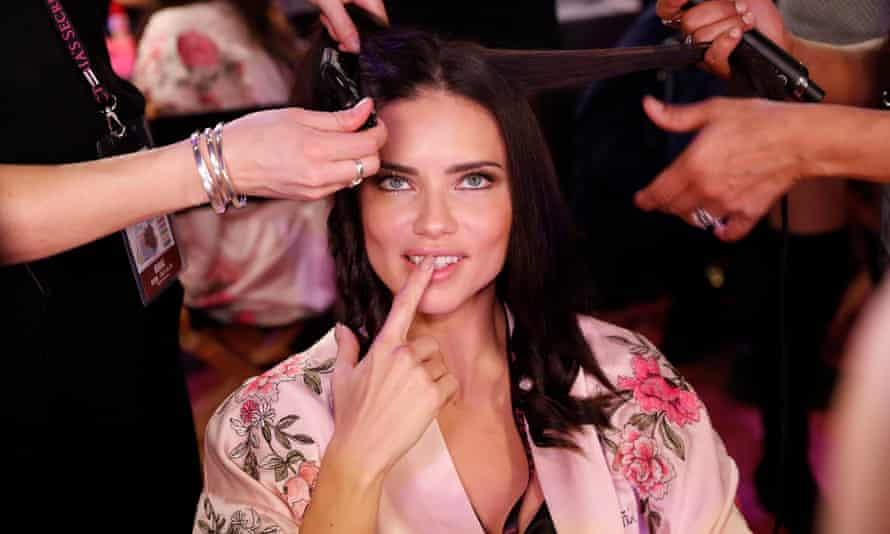Adriana Lima poses backstage before the 2017 Victoria's Secret show in Shanghai