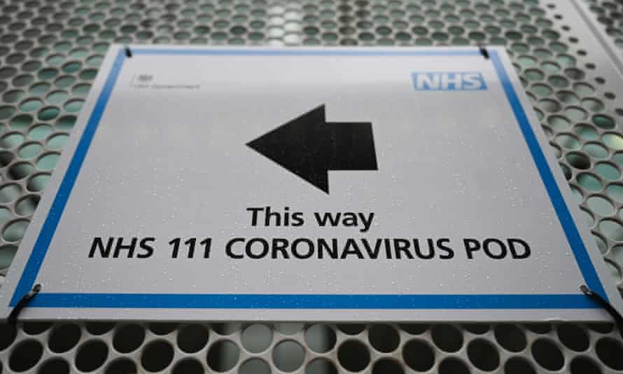 A sign directs patients to an NHS coronavirus pod.