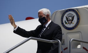 """Put a mask on it""Vice President Mike Pence waves as he arrives to meet with Arizona governor Doug Ducey to discuss the surge in coronavirus cases."