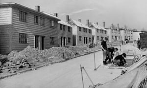 The 'Airey' model of post-war prefabricated house being constructed in Hainault, UK.