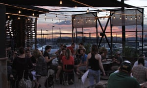 Terrace area, with sunset in the background, at Black Shirt Brewing, Denver.