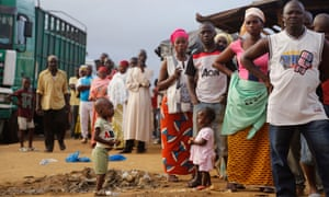 People stand in line to vote during elections in Abidjan, Ivory Coast, in 2015.