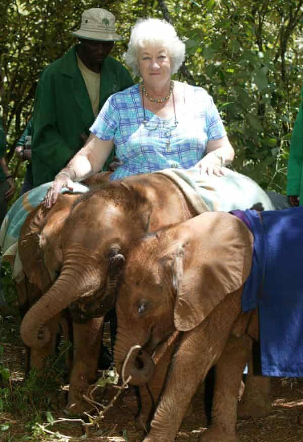 Daphne Sheldrick in 2007 with some orphaned elephants. They are draped in comfort blankets.