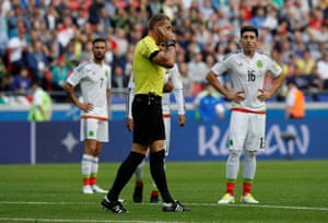 Referee Nestor Pitana reviews a Portugal goal before disallowing it