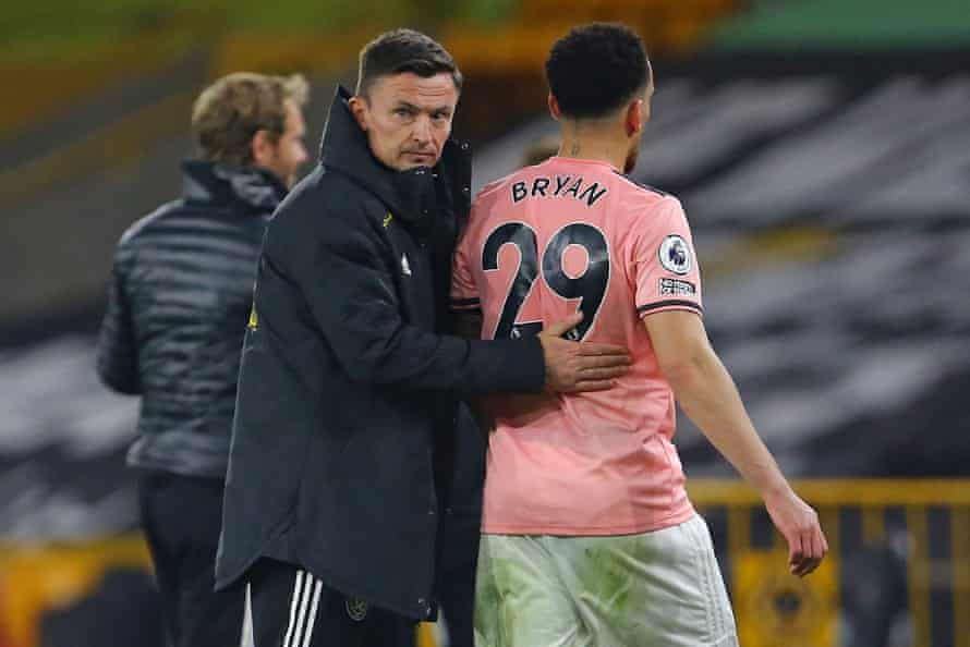 Sheffield United's interim manager Paul Heckingbottom consoles Kean Bryan after the club were relegated from the Premier League