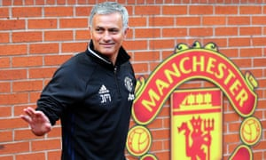 Manchester United's new manager, Jose Mourinho, poses for pictures during a media conference