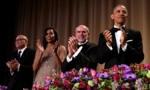 President Barack Obama applauds at the White House Correspondents' Association annual dinner in Washington.