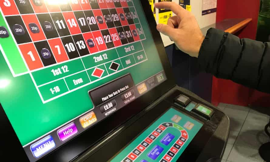 A man gambles on a fixed odds betting terminal.