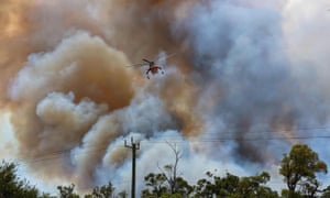 A water bomber helicopter over the bushfire at Kwinana in Western Australia.