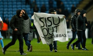 Coventry City fans invade the Ricoh Arena pitch during the game against Sheffield United in a protest against the owners.