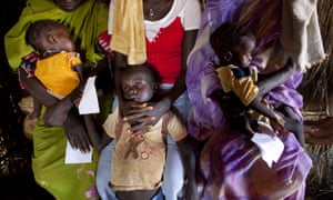 People wait in line for hours to receive medical treatment at the Yida refugee camp in North Sudan.