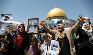 Palestinians take part in a rally in support of Palestinian prisoners held in Israeli jails, in front of the Dome of the Rock.