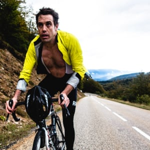 Australian Tim Robertson tries to cool down after a wet morning of harsh climbs.