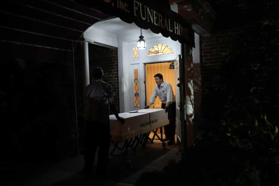Omar Rodriguez and Joseph Neufeld Jr work at a funeral home in Queens, New York City.