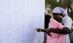 A Kenyan voter checks for her name on lists at a polling station in Nairobi.