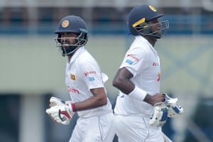 Lahiru Thirimanne (left) and Anjelo Mathews run between the wickets.