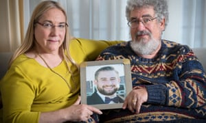 Mary Rich and her husband, Joel Rich, hold a photo of their son in their home in Omaha, Nebraska, on 11 January 2017.