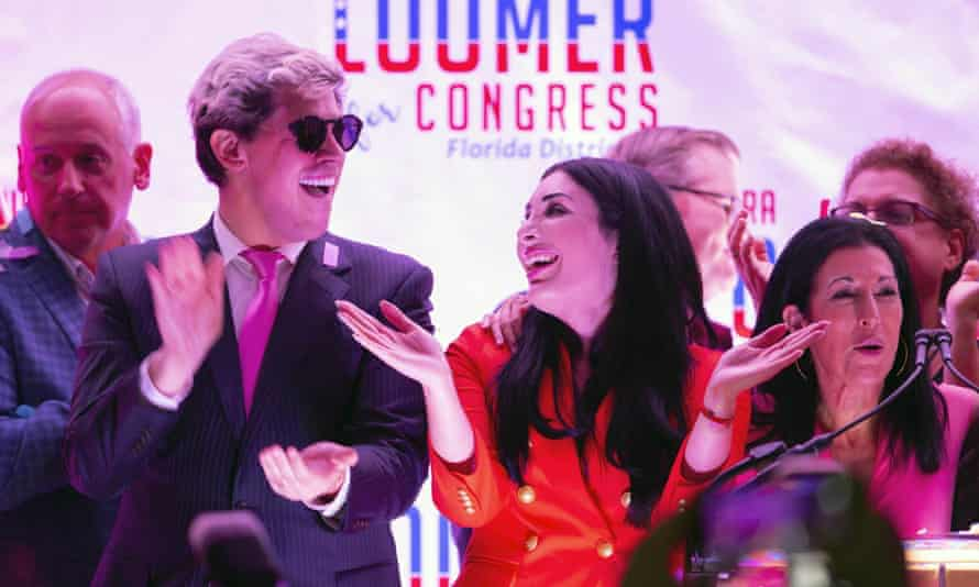 Laura Loomer celebrates with Milo Yiannopoulos, and campaign director Karen Giorno, at an election night event in West Palm Beach, Florida on 18 August 2020.