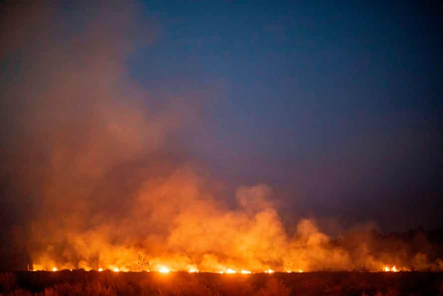 A fire burns out of control after spreading onto a farm along a highway in Nova Santa Helena municipality in northern Mato Grosso State, south in the Amazon basin in Brazil.