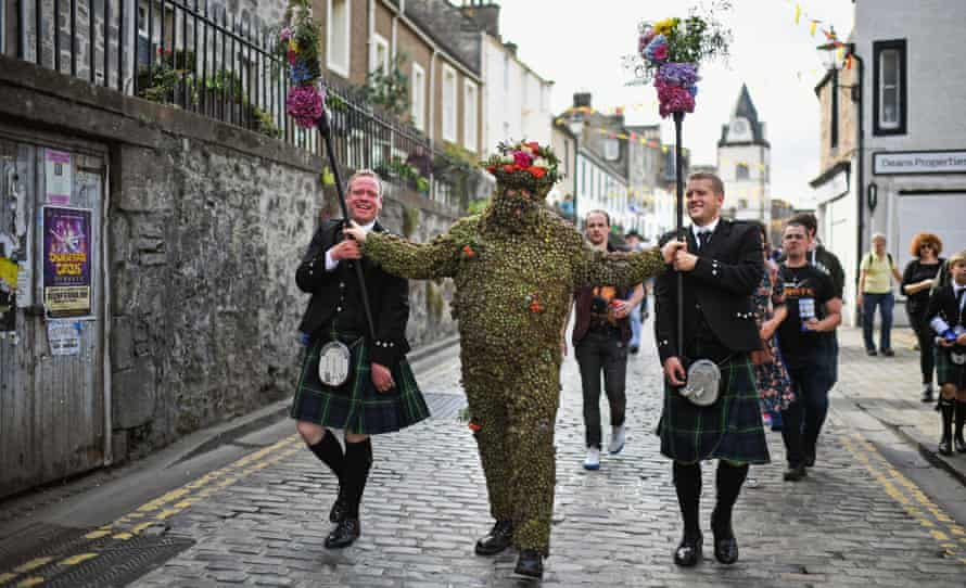 'Nature's Velcro' … The Burryman meets residents in 2017.