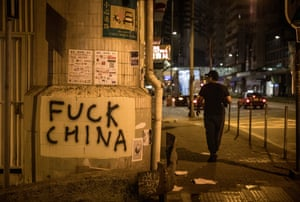Anti-China graffiti on a street after protests on 16 September