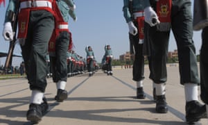 Pakistani soldiers march in a parade