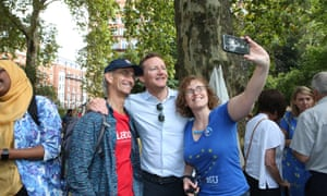 Seb Dance poses with anti-Brexit demonstrators