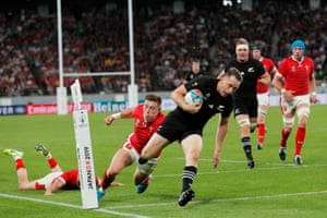 Ben Smith of New Zealand goes over to score their fourth try.