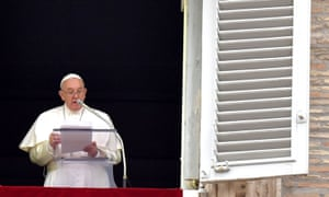 Pope Francis delivers a speech from the window of the apostolic palace overlooking St Peter's Square in The Vatican on April 22, 2019, during the Regina Coeli prayer.