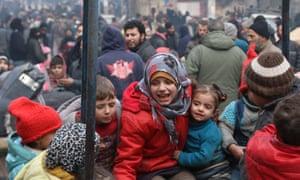 Children wait to be evacuated