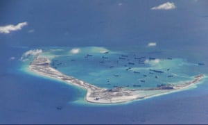 Chinese dredging vessels are purportedly seen in the waters around the disputed Spratly islands in the South China Sea, in this image provided by the US navy.