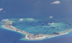 Chinese dredging vessels are purportedy seen in the waters around Mischief Reef in the disputed Spratly Islands in the South China Sea, in this file still image from video taken by a P-8A Poseidon surveillance aircraft and provided by the US Navy on 21 May, 2015.