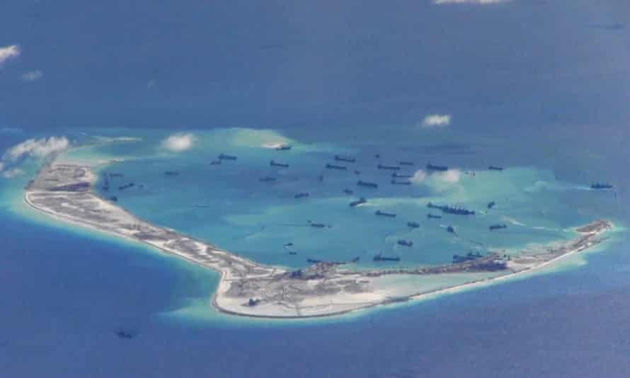 Image from a United States navy video purportedly shows Chinese dredging vessels in the waters around Mischief Reef in the disputed Spratly Islands.