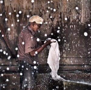 Category: Portrait. Title: Laundry time in India. Dhobi wallah in Cochin, Kerala, India