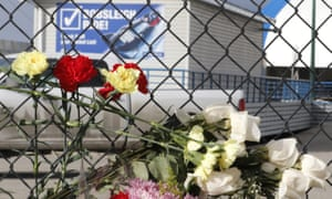 Flowers are placed on a fence near the start area for the bobsled track after Saturday's incident on the track at Canada Olympic Park in Calgary.
