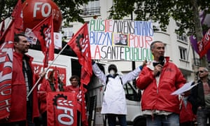 People take part in a demonstration near French Health ministry in Paris on 11 June 11.